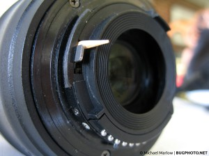 reversed lens with toothpick inserted above aperture lever